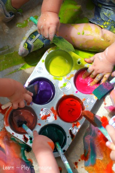 Group play with sidewalk chalk paint - perfect for a play date!