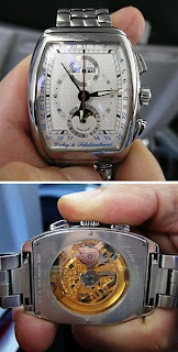 Face Time. Dubey & Schaldenbrand Museum Brand Chrono, gold movement see through back