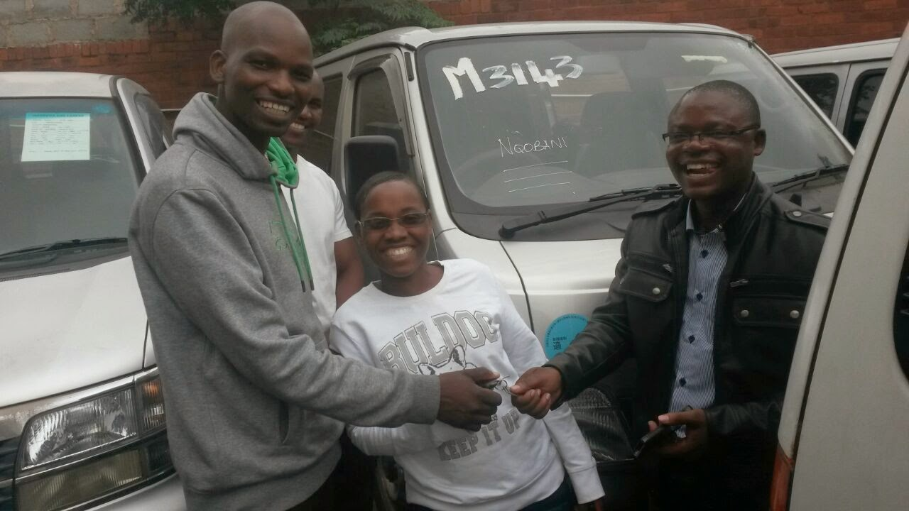 With Mr and Mrs Ncube from Zim after They Bought A used Japanese Nissan Caravan in Durban