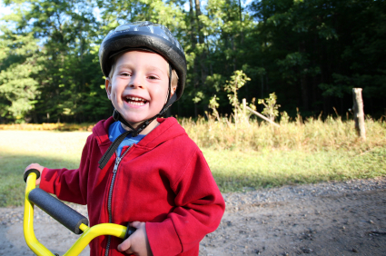 Child with helmet on bike