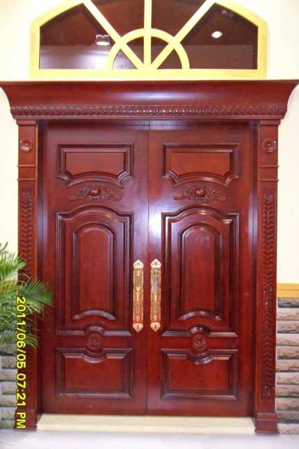 Wooden doors wooden doors kerala for Indian main double door designs