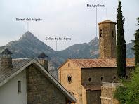 L'església de Sant Joan i la Serra de Picancel al seu darrere, des del cementiri de Vilada