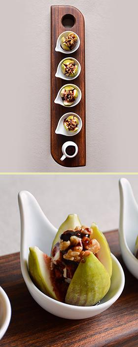 Figos recheados servidos em uma tábua com design sofisticado