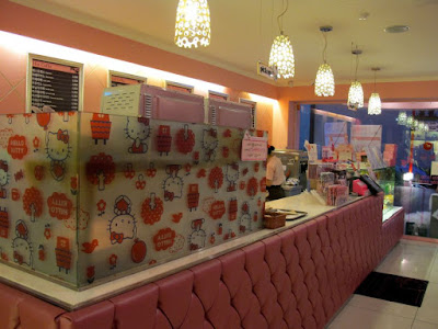 The cashier and cake display at Hello Kitty Cafe Hongdae