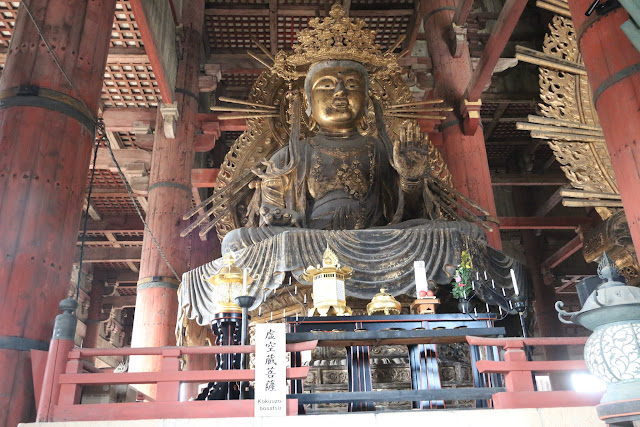 Buddhism bronze statue in Todai-ji Temple at Nara Park, Japan