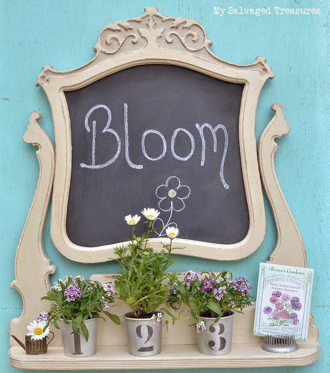Repurposed mirror frame with chalkboard and shelf
