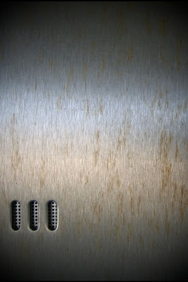 iPhone 4 Metal Wallpaper Theme