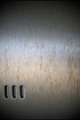 iPhone 4 Metal Wallpaper Theme