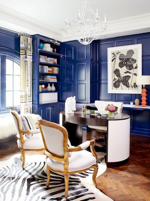 blue lacquered paneled walls office zebra cowhide rug
