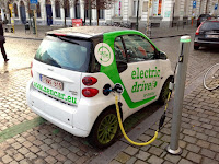 Electric car charging in Brussels, Belgium (Credit: Andrew Nash/flickr)  Click to Enlarge.