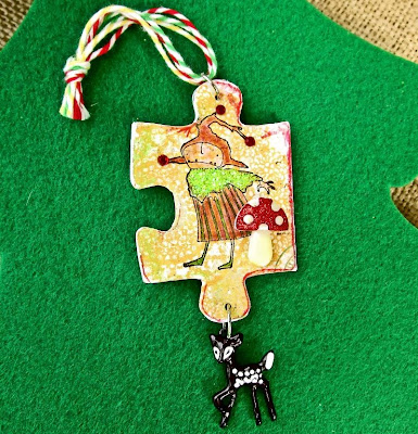 http://dominoartblog.blogspot.com/2013/12/day-11-puzzle-piece-xmas-tree-ornament.html