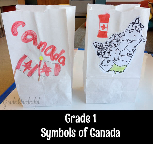 White lunch bags decorated with Canadian flags and a map are used to store our Canadian symbols crafts.
