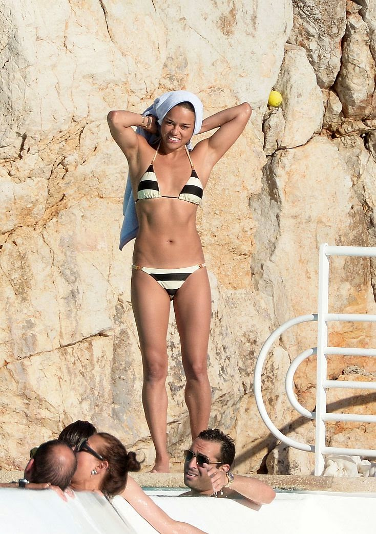 The actress, Michelle Rodriguez turned heads into a great swimwear design from Paula Hermanny during her vacation in Cap d' Antibes, France with male friends, Mohammed Al Turki and Stephanie Seymour son, Peter Brandt. Jr on Saturday, May 24, 2014.