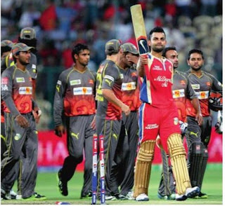Royal Challengers Bangalore Captain Virat Kohli celebrates after guiding his team