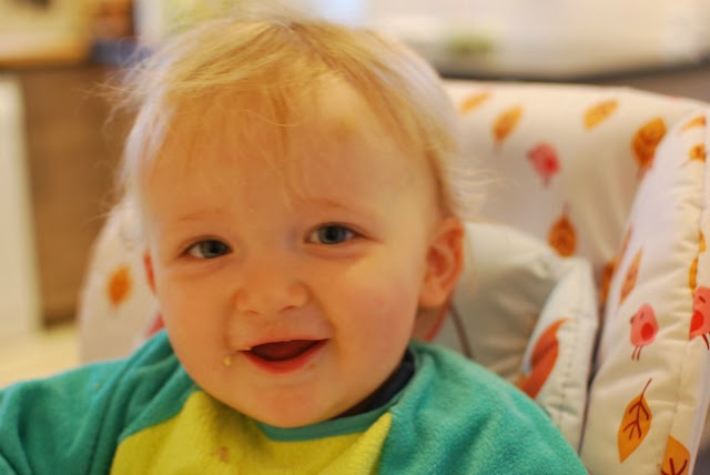 toddler smiling straight at camera