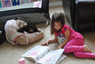 Haley reading to the dog