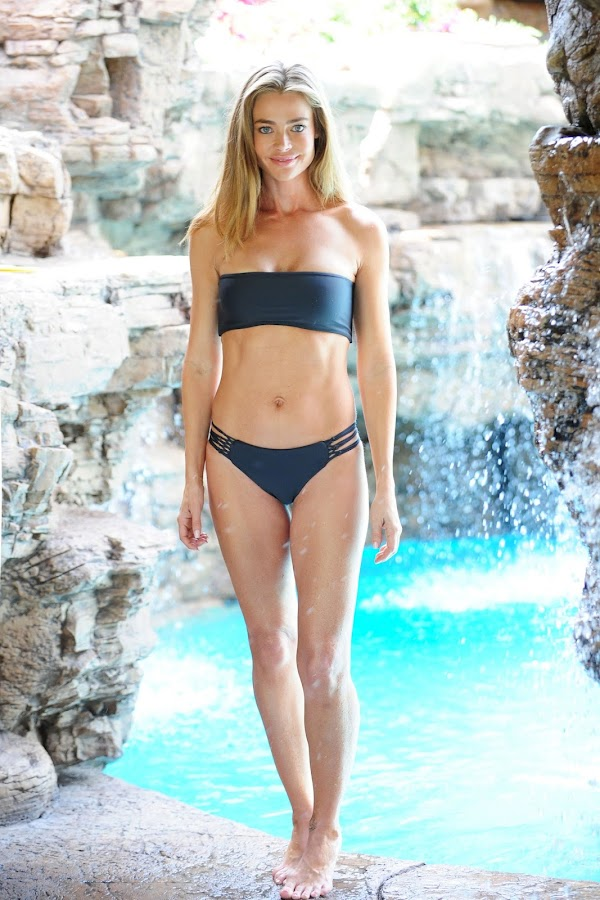 Denise Richards wearing a black bikini in Malibu