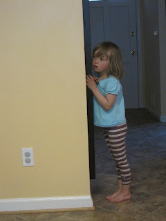 Four-year-old girl in stripey leggings