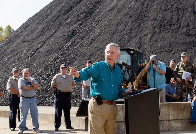 Sen. Mitch McConnell (R-KY) at a Kentucky coal loading facility in October 2014. (Credit: AP) Click to Enlarge.