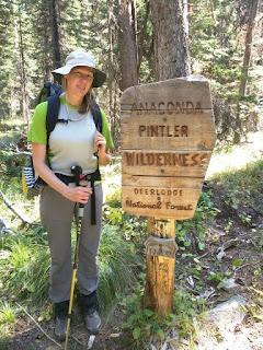 Christine at Anaconda Pintler Wilderness sign.