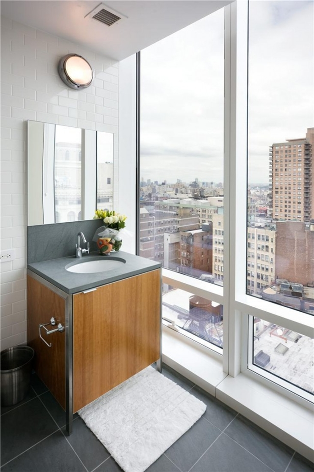 Photo of small sink by the window in one of the most beautiful penthouses