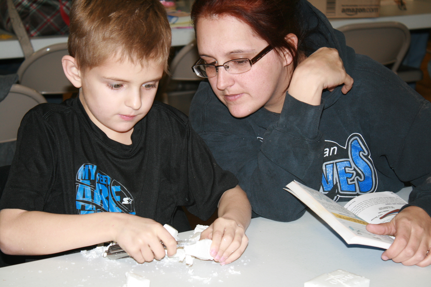 Exeter Cub Scout Blake Meyer and his mother, Heather Meyer, working on