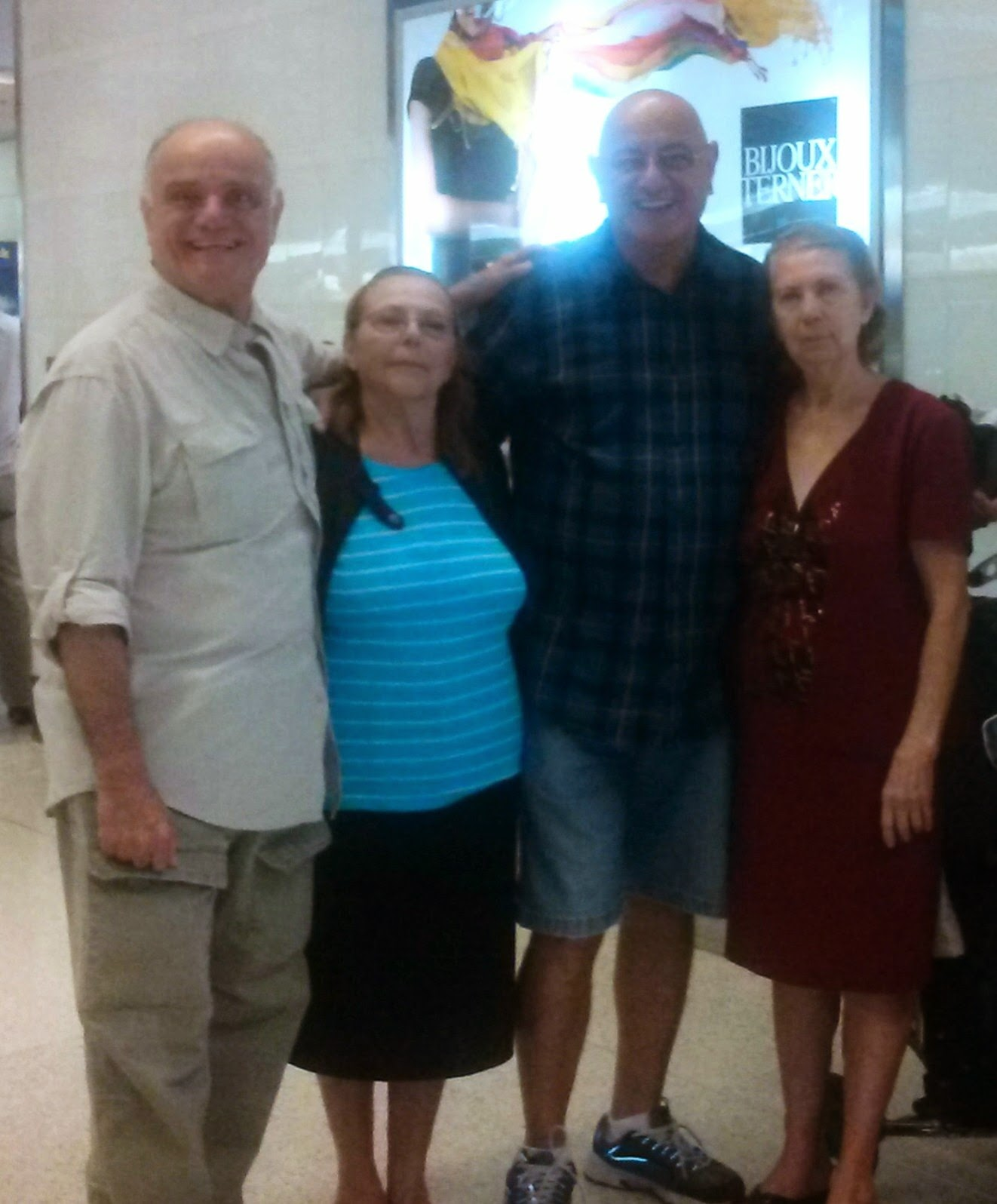 With my aunts and my brother at the airport