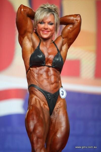 World best bodybuilder girl with headphones