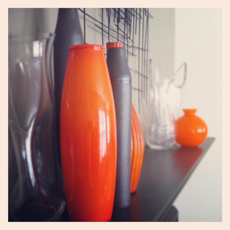 Everywhere orange orange vase on mantle for Orange vase