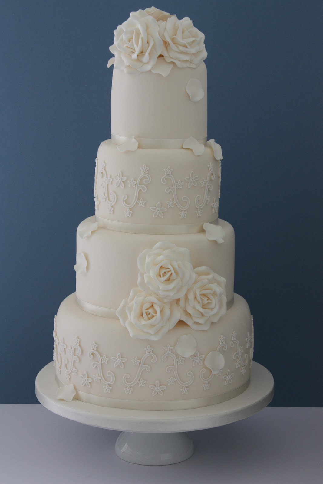 Tiers & Tiaras Ivory Roses & Piped Lace Wedding Cake