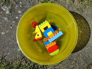 Lego Duplo in a bowl of water
