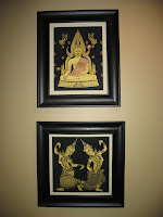 Golden Buddha has beautiful pictures on the wall