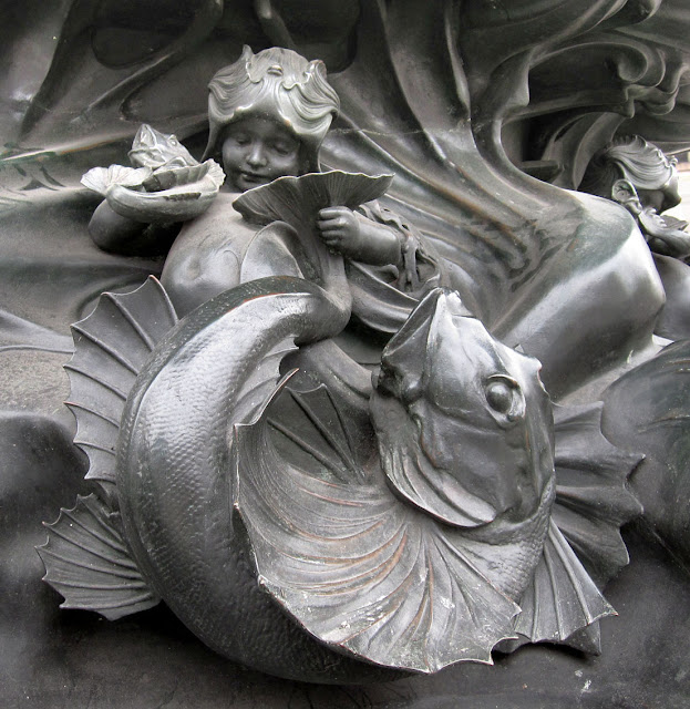 Around the base of the statue of Anteros in Piccadilly Circus.
