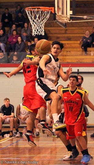 L-R: Kirk Rangiwha-Green, Waikato Pistons; Harris Solomon, Hawke's Bay; Delroi Heu, Waikato Pistons - second division men's basketball at the Hastings Sports Centre, Hastings. Hawke's Bay won 74-66 photograph