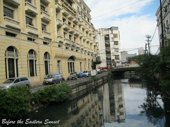 Dirty creek along Kalye Escolta.