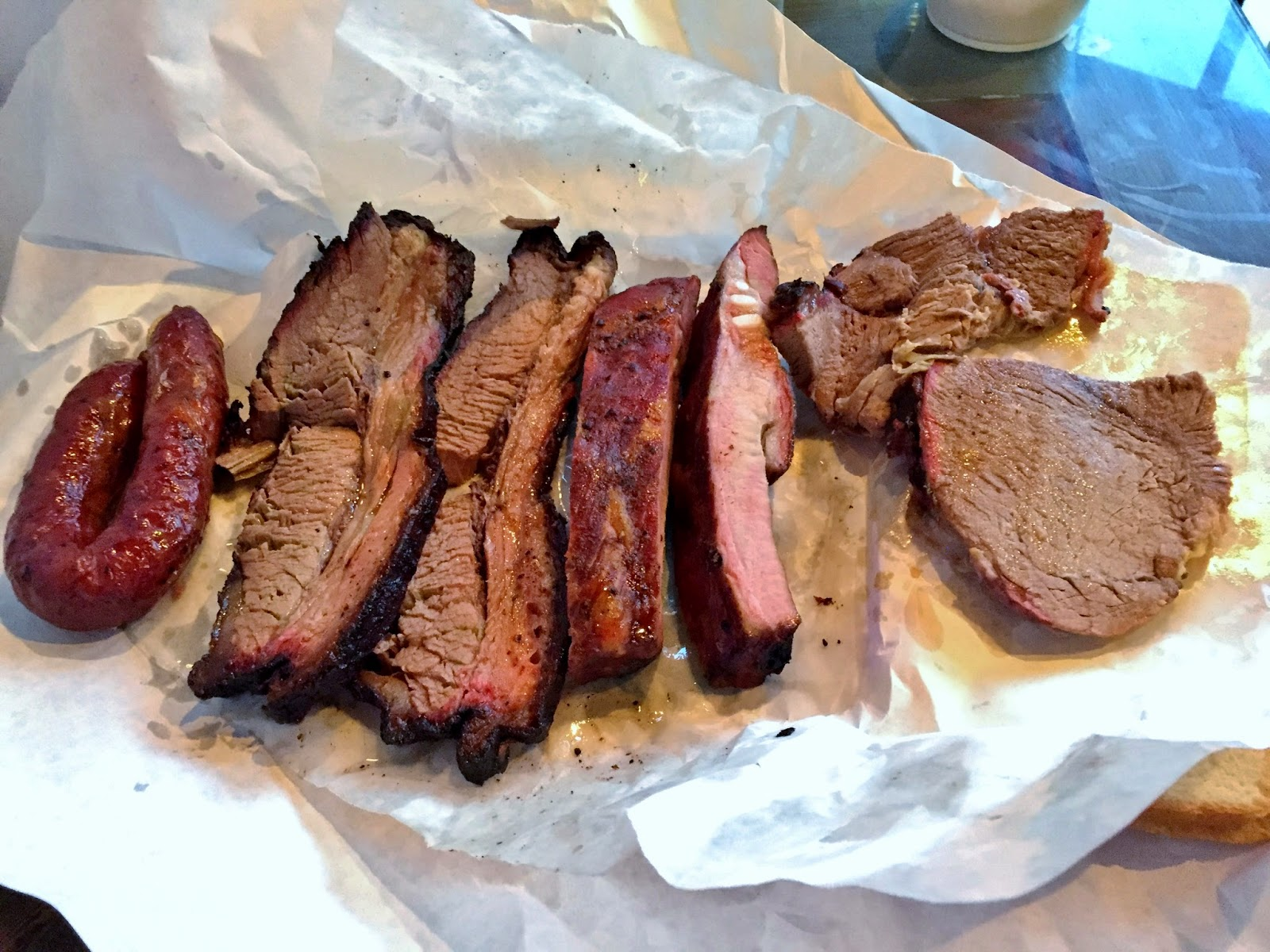 The spread of meats from Plano's Lockhart Smokehouse