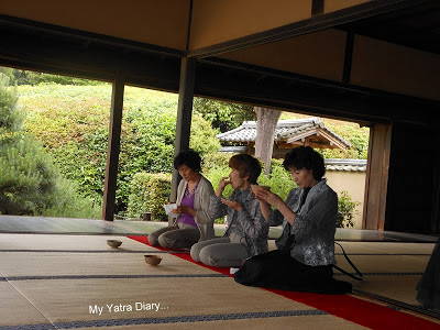 A group of  people taking tea at the Jikoin Zen Temple, Nara - Japan