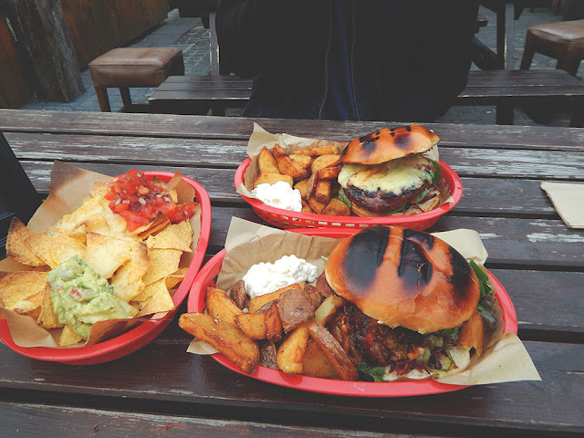 Nacho platter, bacon cheeseburger, pulled pork on a bap.