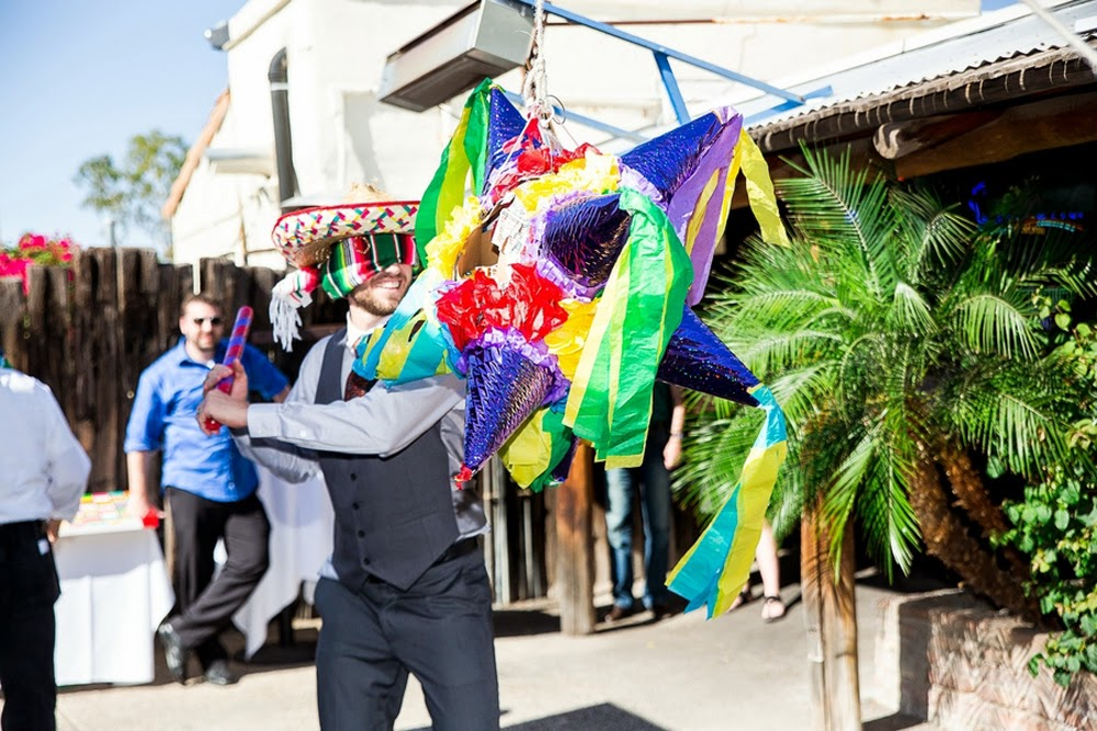 groom hitting pinata, festive mexican themed wedding, aunt chiladas