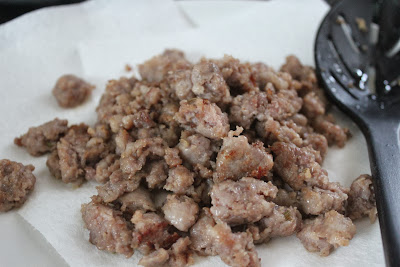 Browned, crumbled sausage