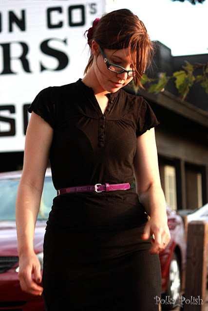 girl with glasses in black pencil skirt, black skirt, purple patent skinny belt