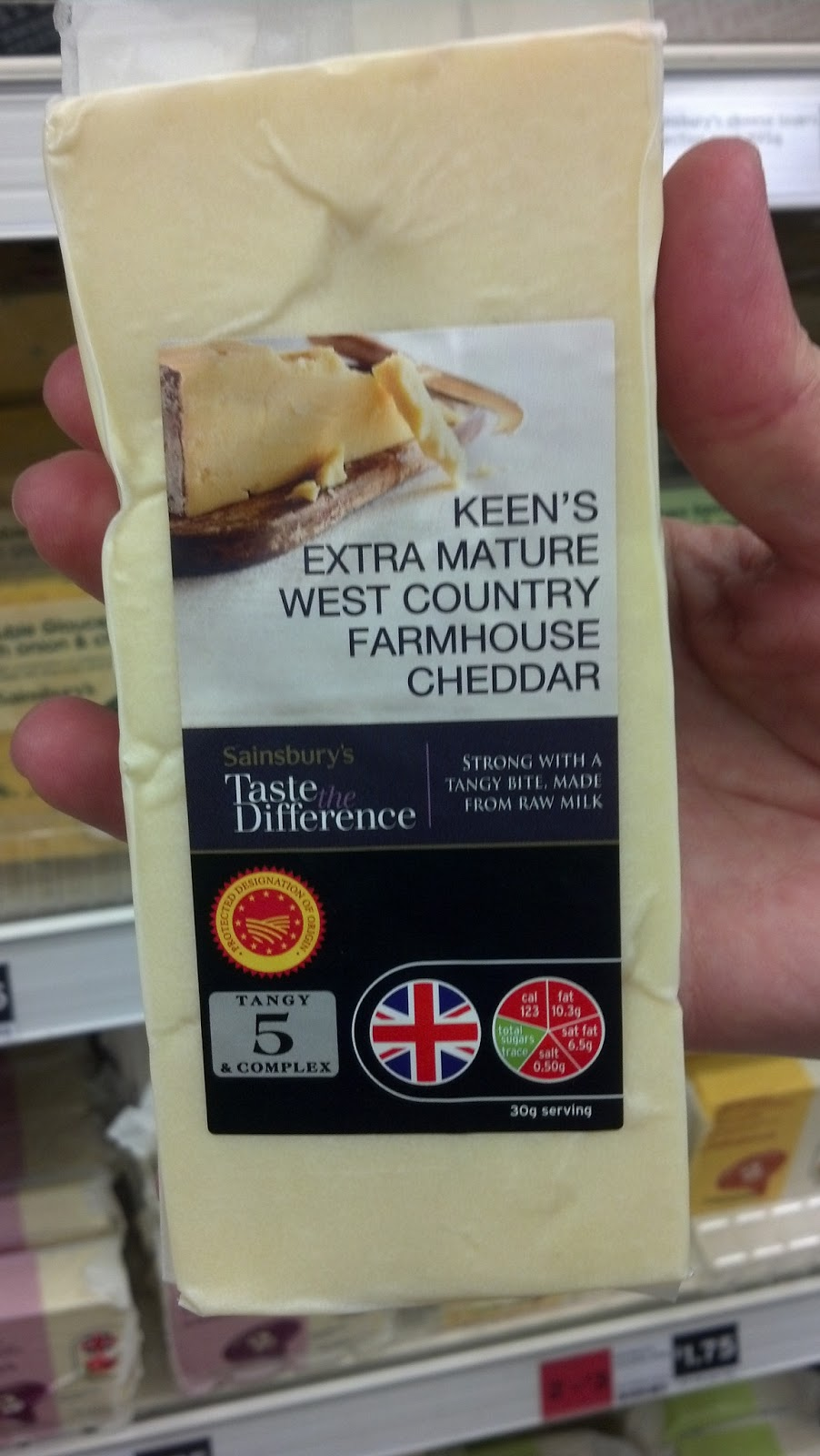 Image shows wedge of Keen's Extra Mature West Country Farmhouse Cheddar