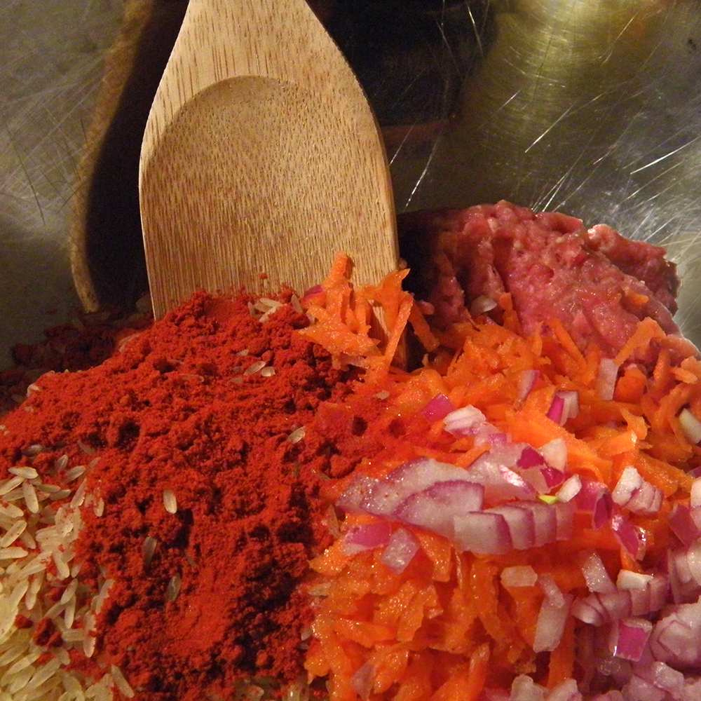 Mixing  Rice, Paprika, Veggies, and Meat