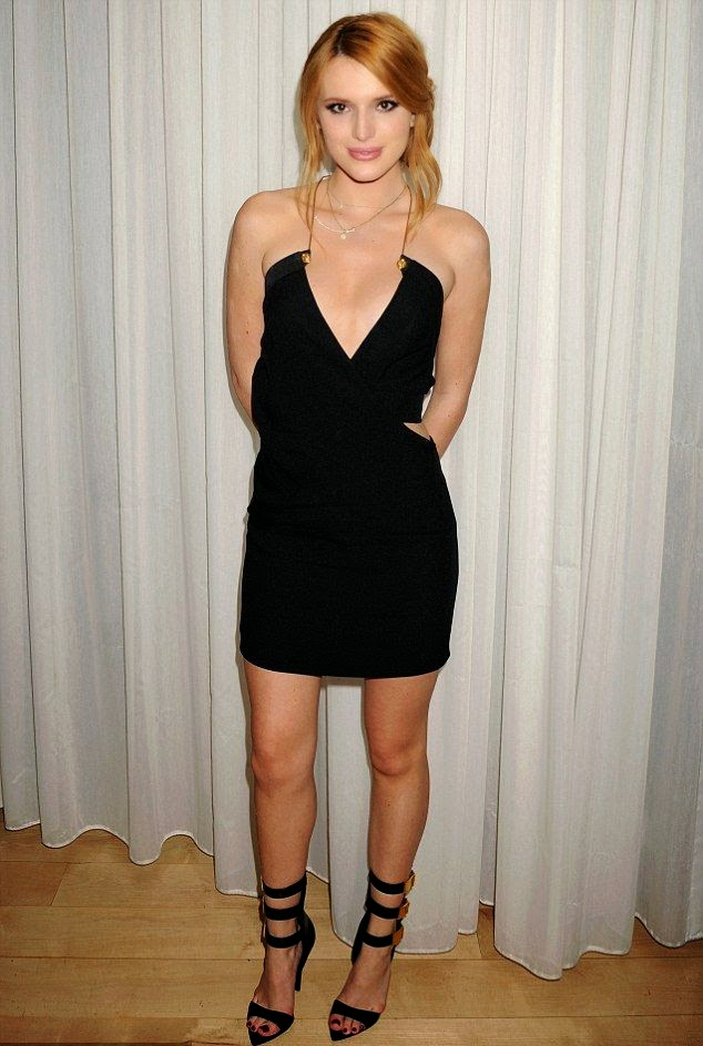 Well that's one way of toughening up the moment and Bella Thorne grabbed an attention in a dark short dress on the party of Latina Magazine's 30 Under 30. The 17-year-old looked a vision as she teamed her hugging figure of legs up on the matching heels while drawing her charm on the brown wooden floor at West Hollywood, CA, USA on Thursday, November 14, 2014.