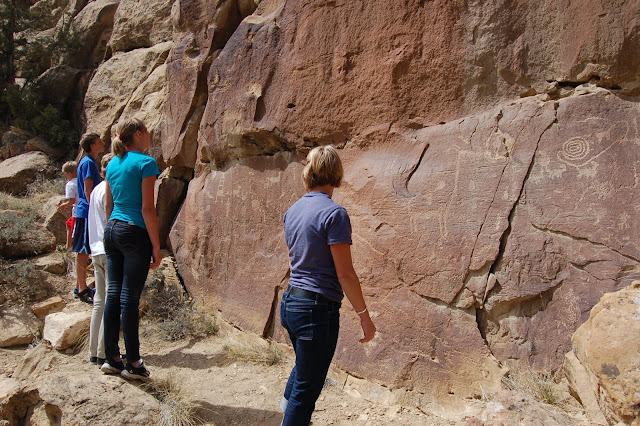 The family at the foot of the Freemont Petroglyph Panel with Long Necked Goat in Nine Mile Canyon Utah
