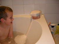 effervescent salts fizzing potion overflowing into bath