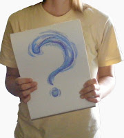 Woman holding a question mark.