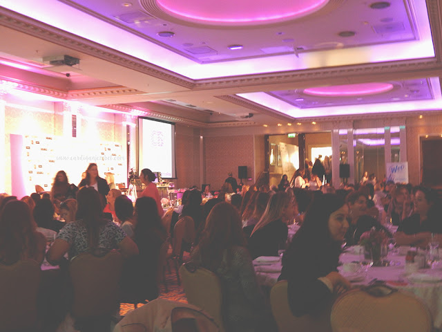 Room full of people at the Cocoa Brown Tan event