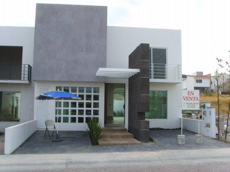 Fachadas contempor neas casa con fachada contemporanea y for Casa contemporanea