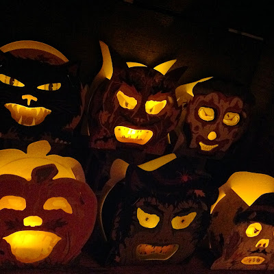 Bindelgrim set of six Creeps (vintage-style candy-container slot-tab lanterns glowing with candle light at night)